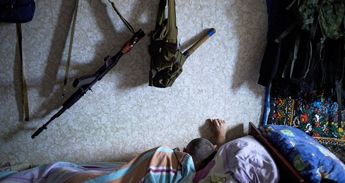 A member of a rapid response unit rests in a barrack before a curfew patrol in Lugansk