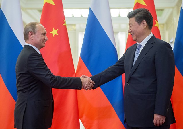 Russian President Vladimir Putin (left) and Chinese President Xi Jinping seen before the beginning of Russian-Chinese talks at the Great Hall of the People in Beijing, September 3, 2015