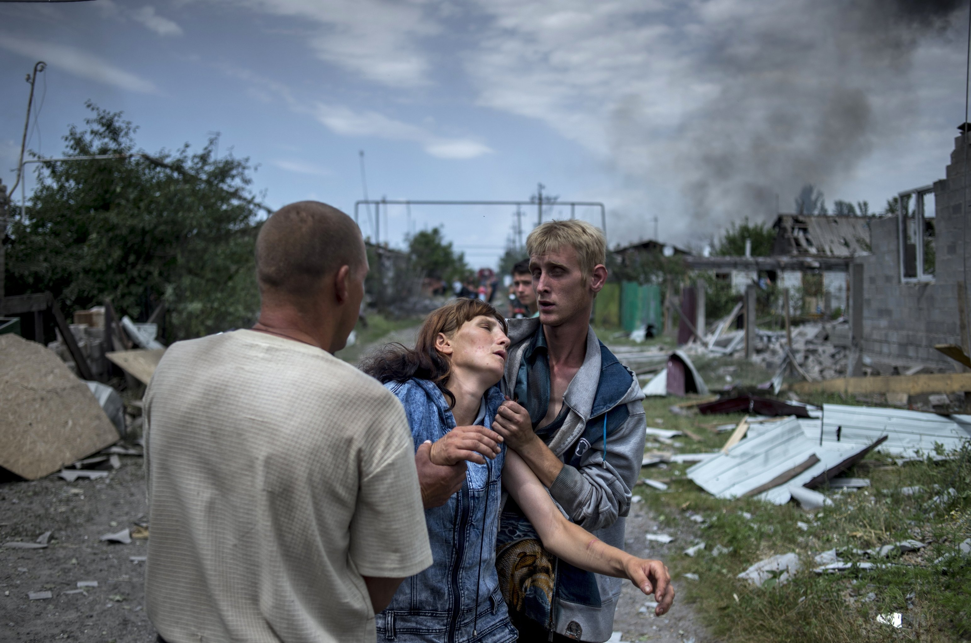 Local residents in the village of Luganskaya after the Ukrainian armed forces' air attack