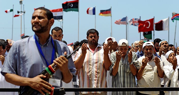 Libyans pray during Friday prayers, in the rebel-held Benghazi, Libya, Friday, July 8, 2011.