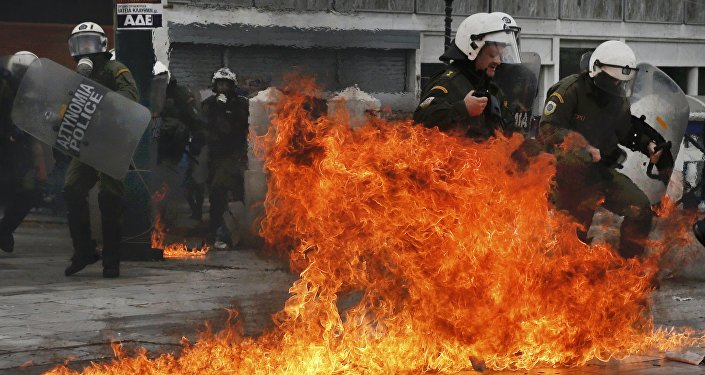 Riot police react to petrol bombs thrown by masked youths in Syntagma Square during a 24-hour general strike against planned pension reforms in Athens, Greece, February 4, 2016