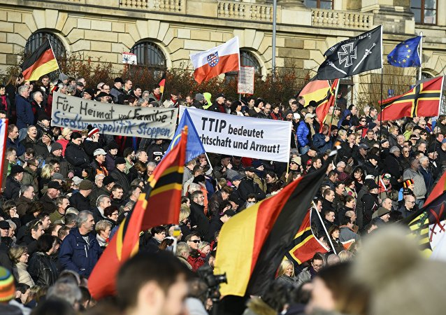 Supporters of the Pegida movement (Patriotic Europeans Against the Islamisation of the Occident) gather in Dresden, eastern Germany
