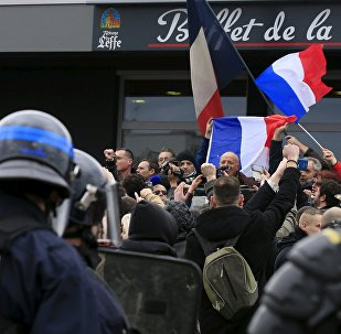 Activists against migrants shout slogans as retired French General Christian Piquemal makes an address during a protest organized by the anti-Islam group PEGIDA, in Calais, France