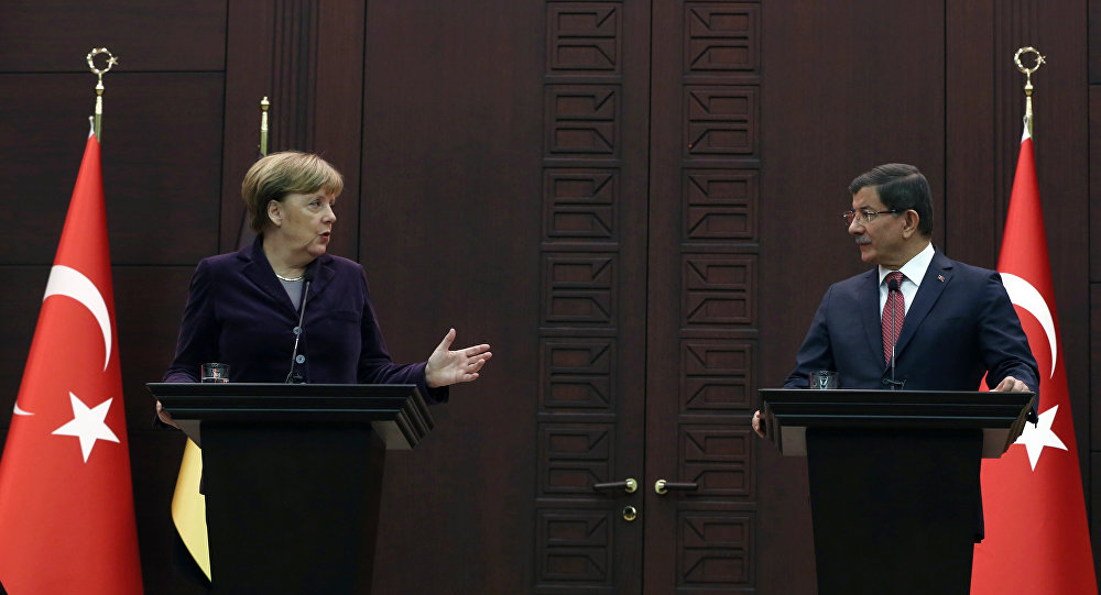 German Chancellor Angela Merkel, left, speaks to the media during a joint news conference with Turkish Prime Minister Ahmet Davutoglu in Ankara, Turkey, Monday, Feb. 8, 2016.