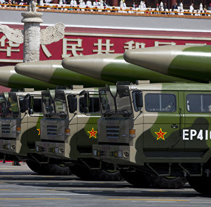 Military vehicles carrying DF-26 ballistic missiles drive past Tiananmen Gate during a military parade at Tiananmen Square in Beijing on September 3, 2015, to mark the 70th anniversary of victory over Japan and the end of World War II