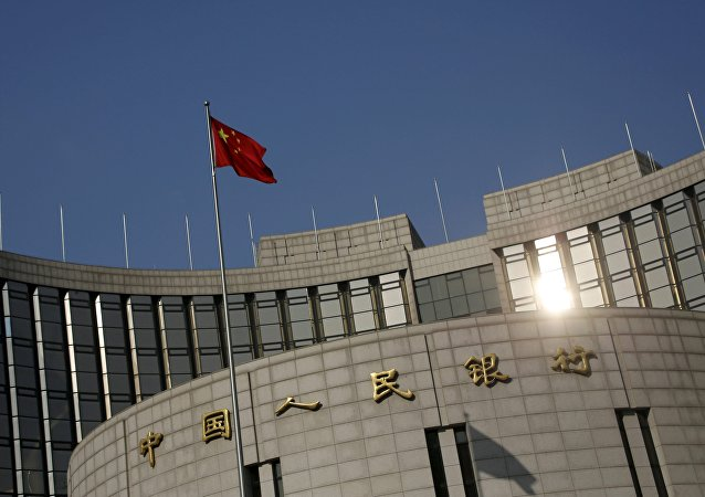 A Chinese national flag flies at the headquarters of the People's Bank of China, the country's central bank, in Beijing, China, January 19, 2016