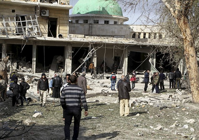People inspect the damage after airstrikes by pro-Syrian government forces in the rebel held al-Sakhour neighbourhood of Aleppo, Syria February 5, 2016