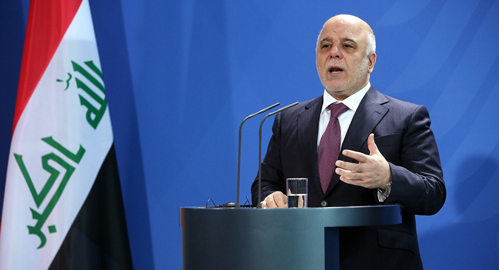 Iraqi Prime Minister Haider al-Abadi speaks at a joint press conference with German Chancellor