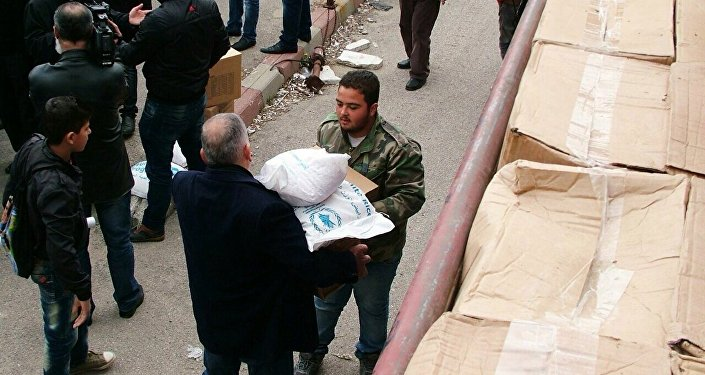 Russia's military has delivered humanitarian aid to the Syrian town of Deir al-Fardis in the Hama province.