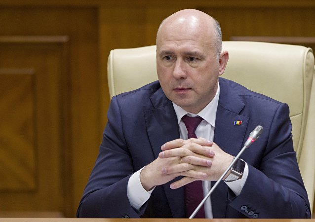 Moldova's Democratic Party member of parliament and newly elected prime minister Pavel Filip attends a session of parliament in Chisinau, Moldova, January 20, 2016