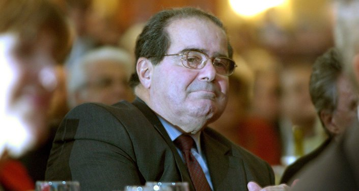 U.S. Supreme Court Justice Antonin Scalia sits in the audience at a National Italian American Foundation event in Washington, in this file photo taken October 20, 2006.