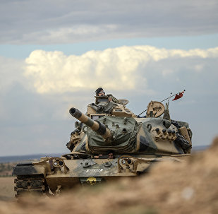 Turkish army tanks take position near the Syrian border
