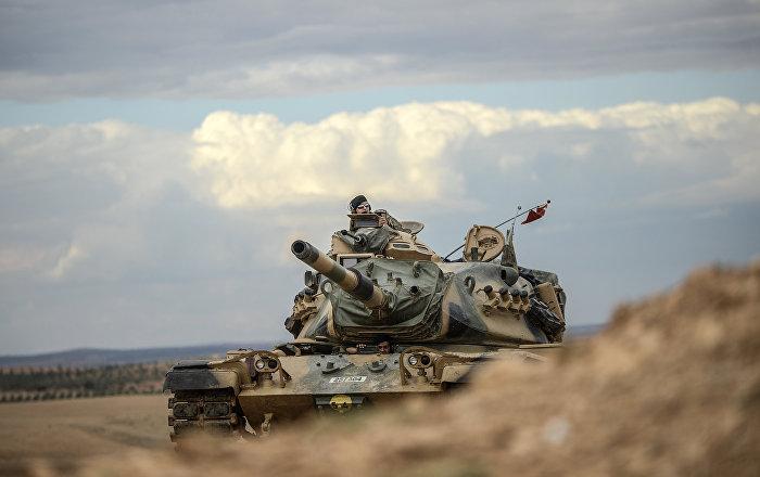 Turkish army tanks take position near the Syrian border (file photo)