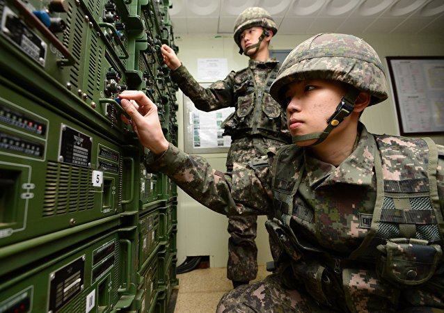 South Korean army soldiers adjust equipment used for propaganda broadcasts near the border area between South Korea and North Korea in Yeoncheon, South Korea, Friday, Jan. 8, 2016
