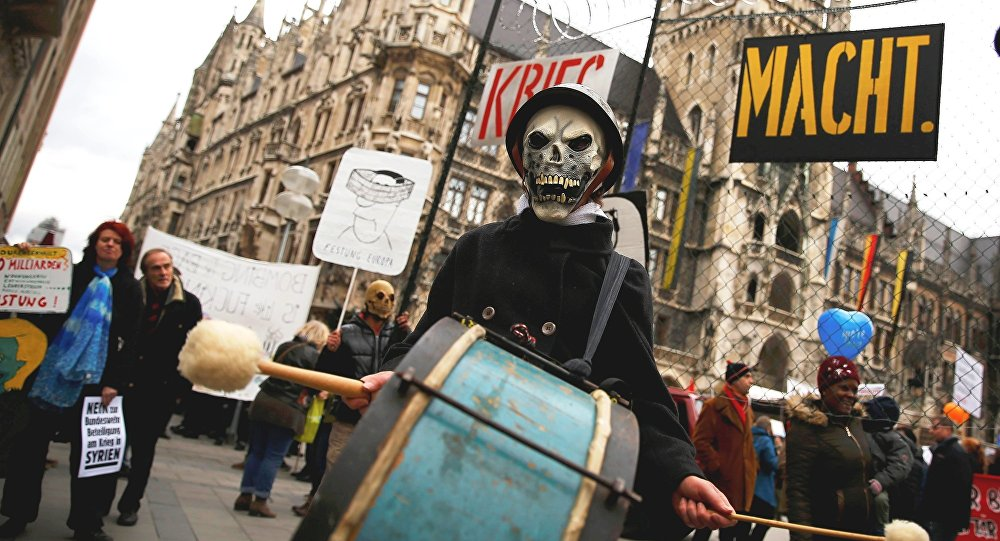 A protester takes part in a demonstration against the Munich Security Conference in downtown Munich, Germany, February 13, 2016.