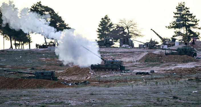 Tanks stationed at a Turkish army position near the Oncupinar crossing gate close to the town of Kilis, south central Turkey, fire towards the Syria border, on February 16, 2016.