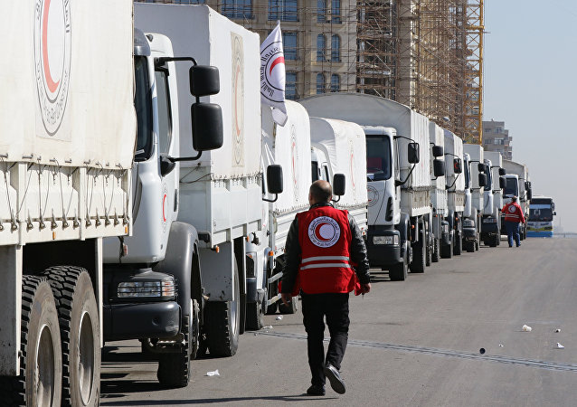 A Red Crescent convoy prepares to leave Damascus to the besieged areas of Madaya and Zabadani, on February 17, 2016 during an operation in cooperation with the UN to deliver aid to thousands of besieged Syrians