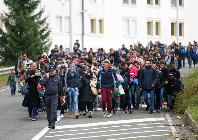 Migrants and refugees across the Slovenian-Austrian border in Sentilj towards Spielfeld on October 18, 2015.