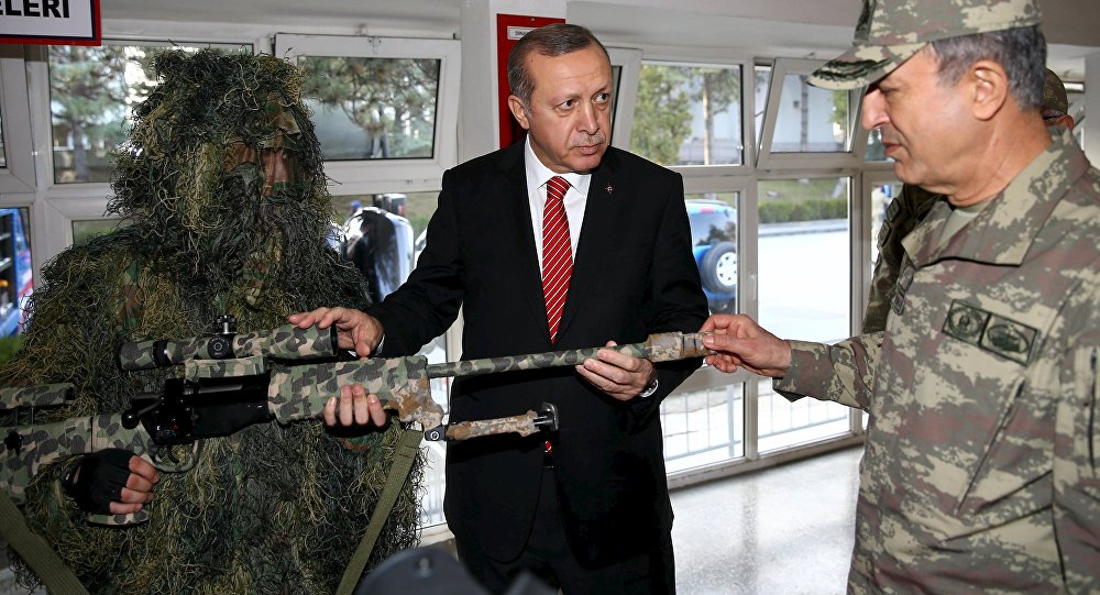 Turkish President Tayyip Erdogan (C) gets a briefing from Chief of Staff General Hulusi Akar (R) during his visit to the Gendarmerie Commando Special Forces headquarters in Ankara, Turkey, in this February 16, 2016