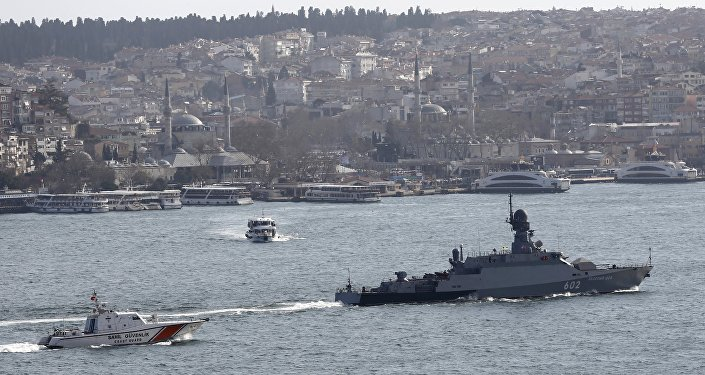 The Russian Navy's missile corvette Zeleny Dol (R) is escorted by a Turkish Navy Coast Guard boat as it sets sails in the Bosphorus, on its way to the Mediterranean Sea, in Istanbul, Turkey February 14, 2016