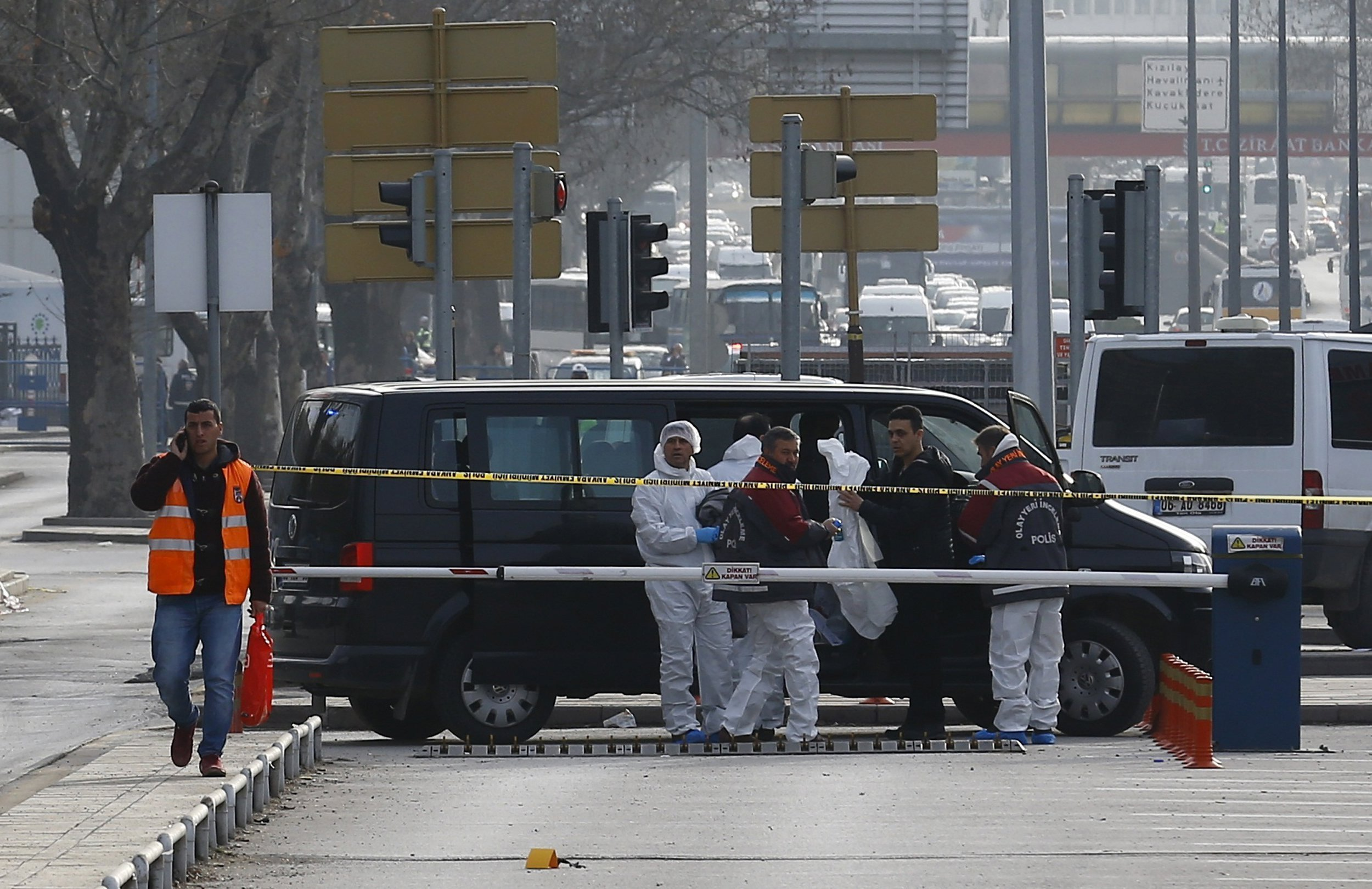 Forensic experts arrive at the of site last night's explosion in Ankara, Turkey