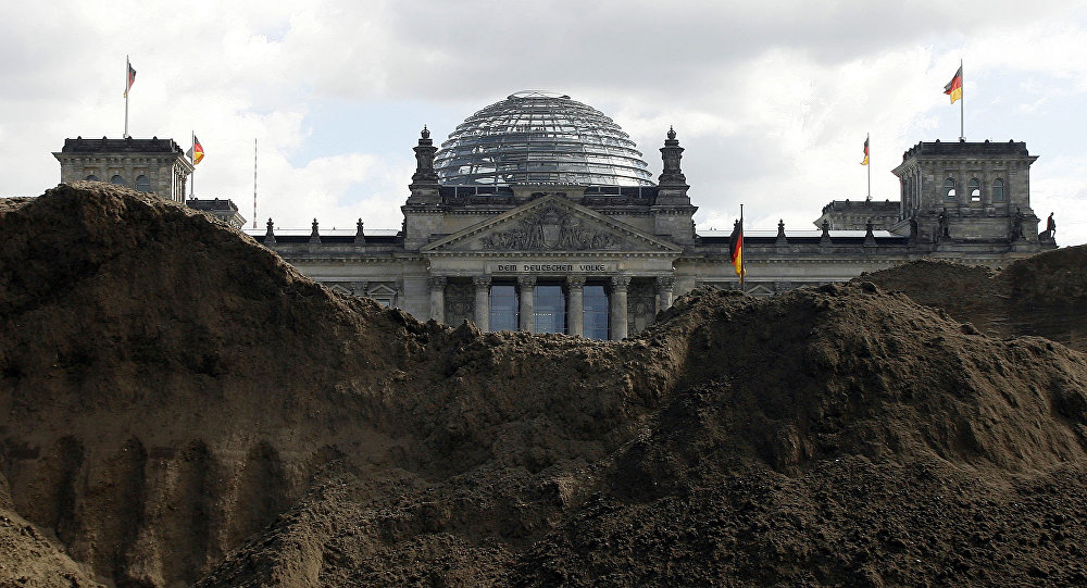 German Parliament building the Reichstag Building seen behind a pile of mud (File)