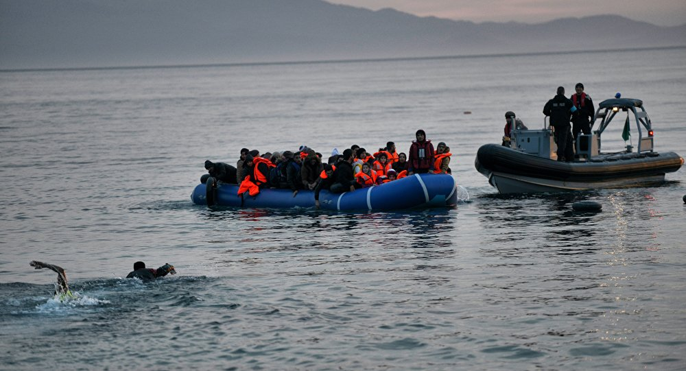 Refugees an an inflatable boat