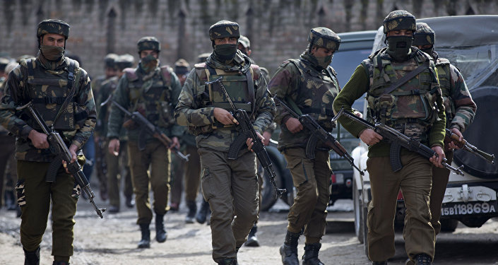 Indian police men secure the area of gunbattle with suspected rebels in Hajin Village some 38 Kilometers (23.75 miles) northeast of Srinagar, Indian controlled Kashmir, Thursday, Feb. 4, 2016