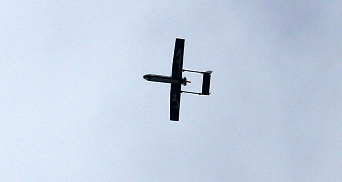 A drone belonging to the Ezzedine al-Qassam Brigades, Hamas' armed wing, flies over Gaza City on December 14, 2014