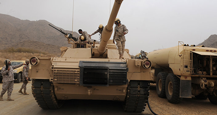 Saudi soldiers are seen on top of their tank deployed at the Saudi-Yemeni border, in Saudi Arabia's southwestern Jizan province, on April 13, 2015.
