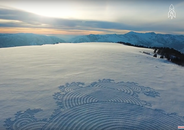 Man treads tremendous snow murals in the mountains