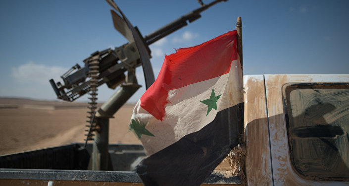 A Syrian flag on a truck with a machine gun of the Syrian Arab Army (SAA) near the town of Mhin, Syria