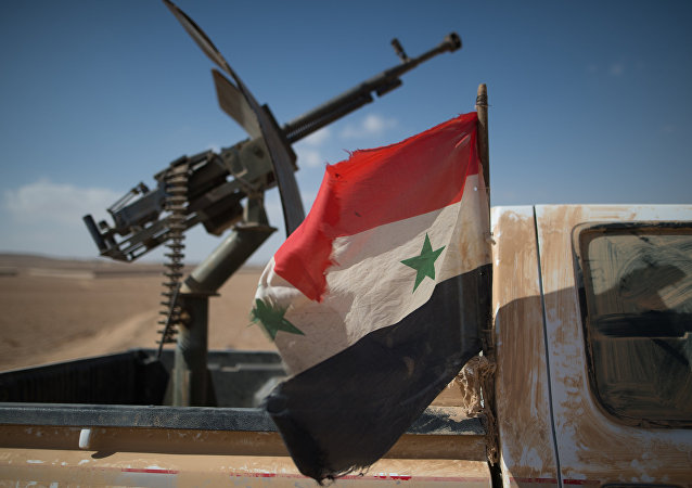A Syrian flag on a truck with a machine gun of the Syrian Arab Army (SAA)