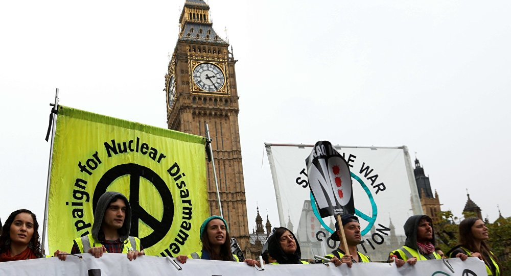 Supporters of the 'Stop the war' coalition and 'Campaign for Nuclear Disarmament' march through central London.