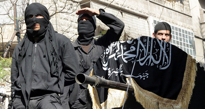 Members of jihadist group Al-Nusra Front take part in a parade calling for the establishment of an Islamic state in Syria, at the Bustan al-Qasr neighbourhood of Aleppo, on October 25, 2013