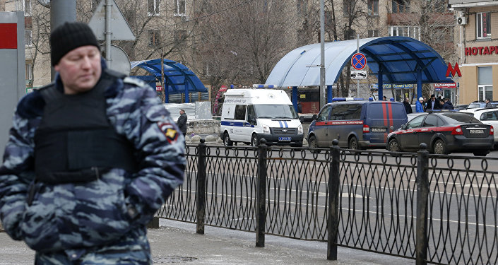 A Russian police officer stands at the site where a woman suspected of murdering a young child was detained, near Oktyabrskoye Pole metro station in Moscow, Russia, February 29, 2016.