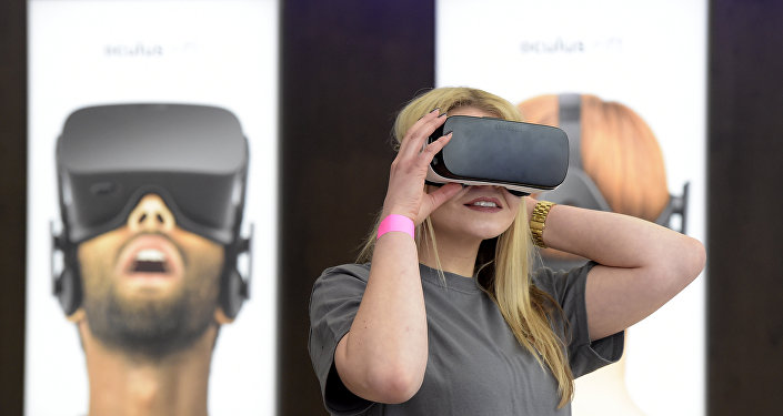 A woman uses a virtual reality device.