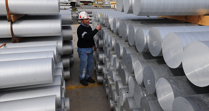 Aworker checks aluminium bars on February 15, 2010 at the US aluminium company Alcoa's plant in Portovesme. (File)
