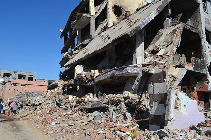 According to media reports, 32 bodies were found in the basement floor of a house destroyed during bombings in the Cudi district.