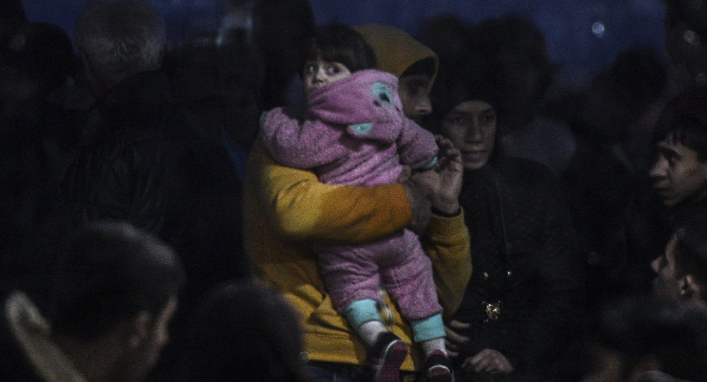 Syrian refugees are detained by the Turkish coastguard after they tried to reach the Greek island of Lesbos on March 3, 2016, Kucukkuyu, Canakkale.