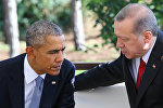 Turkish President Recep Tayyip Erdogan (R) speaks with US President Barack Obama (L) during a bilateral meeting on the sidelines of the G20 Turkey Leaders Summit in Antalya. (File)