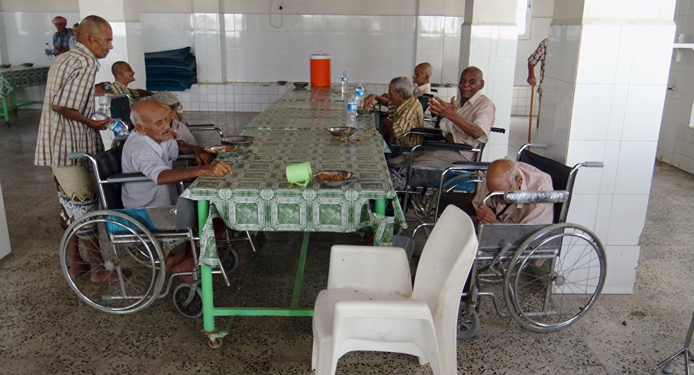 Elderly residents of an old people's home sit in the home's dinning hall after it was attacked by gunmen in the Yemeni port of Aden March 4, 2016