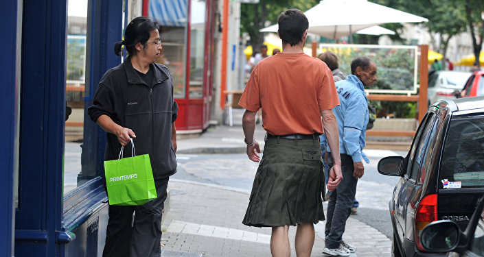 Dominique Moreau, the president of Hommes en Jupe (Men in Skirts), a group of 30 men from western France who wear skirts in their everyday lives, is walking along a street in the city of Poitiers in western France.