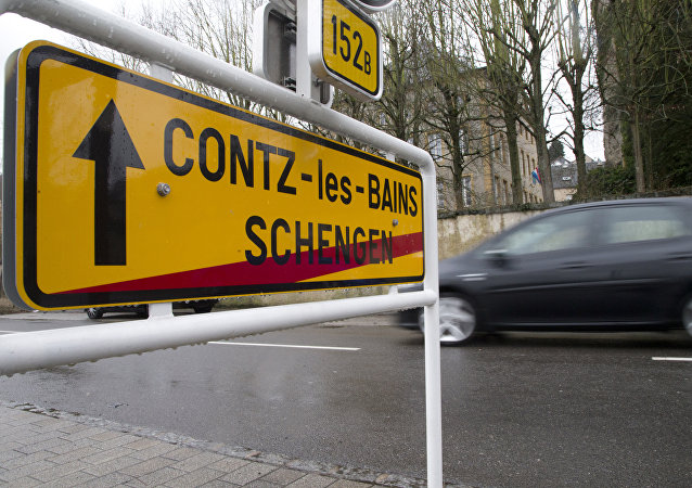 In this photo taken on Thursday, Feb. 4, 2016, a car drives out of Schengen, Luxembourg and into Contz-les-Bains, France