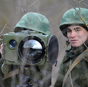Soldiers of the technical intelligence unit handle an Ironia optical surveillance system during exercise of the Southern Military District special mission brigade in the Krasnodar Territory. The small-size multi-functional electronic optical device is designed for real-time obtaining and processing of information
