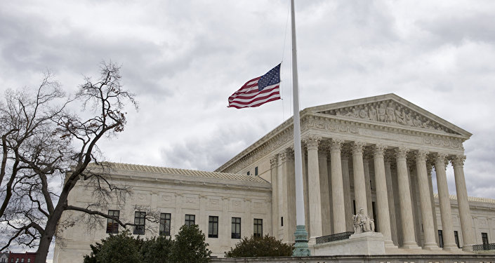 In this Feb. 25, 2016, file photo, in honor of Justice Antonin Scalia, a flag in the Supreme Court building's front plaza flies at half-staff in Washington