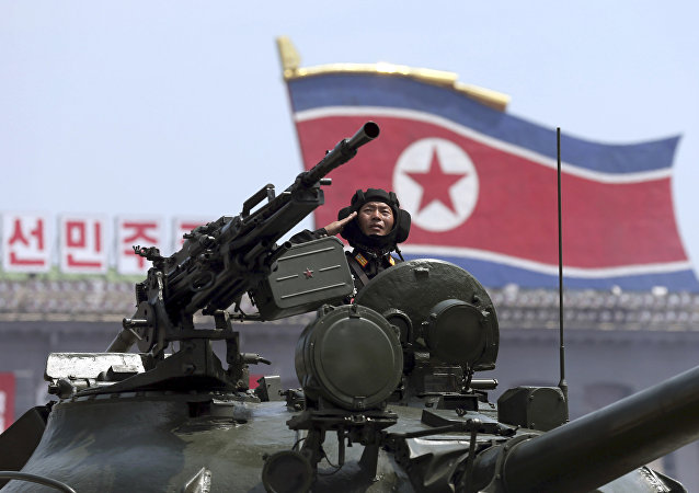 In this Saturday, July, 27, 2013, file photo, a North Korean soldier salutes while in a military tank as they parade through Kim Il Sung Sqaure during a mass military parade celebrating the 60th anniversary of the Korean War armistice in Pyongyang, North Korea