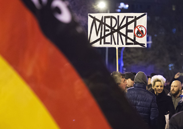 People wave German flags in Erfurt, central Germany,during a demonstration initiated by the Alternative for Germany (AfD) party against the immigration situation (File)