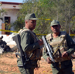 Tunisian soldiers stand guard at the scene of an assault on a house outside the town of Ben Guerdane near the border with Libya on March 3, 2016