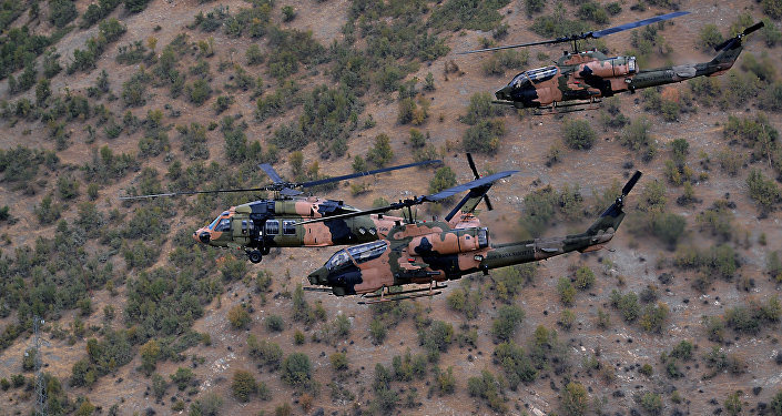 Military helicopters fly close to protect Turkish President Abdullah Gul and top army commanders aboard other helicopters over Hakkari province, Turkey as he visits Turkish troops at the border with Iraq.